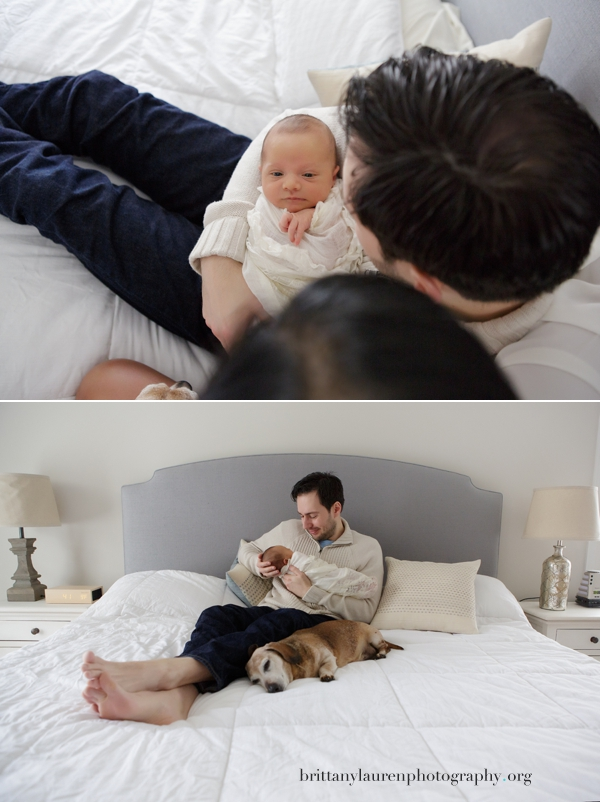 Dad with newborn baby and dog