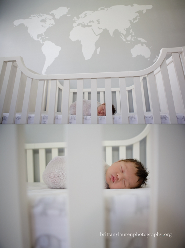 Grey nursery with world map above the crib